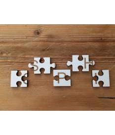 Puzzelstukjes met gravure